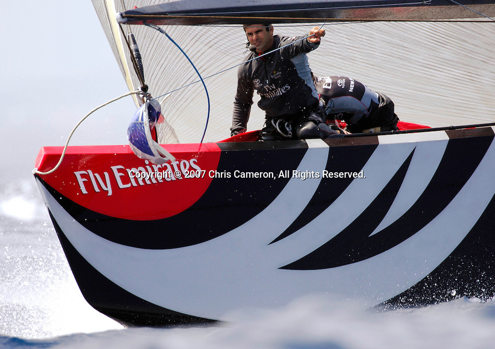 Emirates Team New Zealand bowman  on NZL92 Jeremy Lomas readies the spinnaker approaching the first top mark chasing Alinghi SUi100 in race four of the 32nd America`s Cup. 27/6/2007