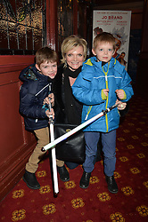 SHARON SMALL with her sons left to right, LEO BRIDGES and ZAC BRIDGES at a VIP evening for the pantomime Aladdin at The New Wimbledon Theatre, The Broadway, Wimbledon, London SW19 on 9th December 2013.