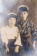 deteriorating studio portait of two Asian boys Japan ca 1930s