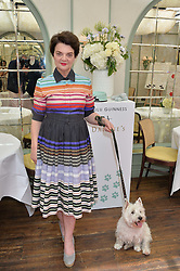 LULU GUINNESS and her dog Daphne at a party hosted by Lulu Guinness and Daphne's to launch Lulu's Designer Dog Bowl and to mark Daphne's allowing dogs through it's doors, held at Daphne's, Draycott Avenue, London on 28th June 2016.