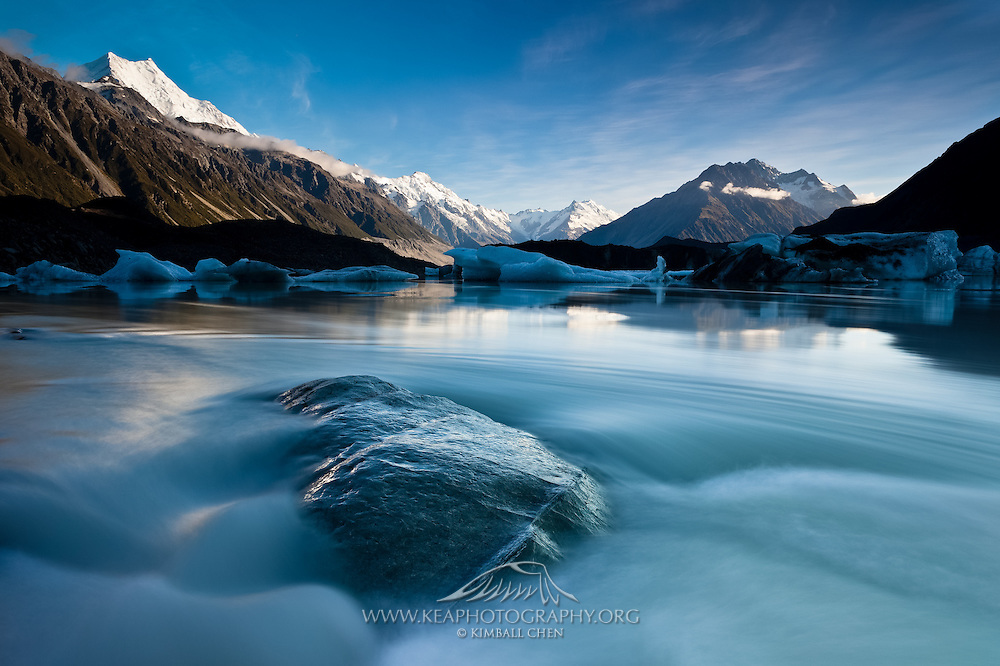 Icebergs floating on Tasman Glacier Lake, with Mount Cook in the distance