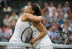 LONDON, ENGLAND - Tuesday, June 28, 2011: Sabine Lisicki (GER) consoles Marion Bartoli (FRA) after winning the Ladies' Singles Quarter-Final match on day eight of the Wimbledon Lawn Tennis Championships at the All England Lawn Tennis and Croquet Club. (Pic by David Rawcliffe/Propaganda)