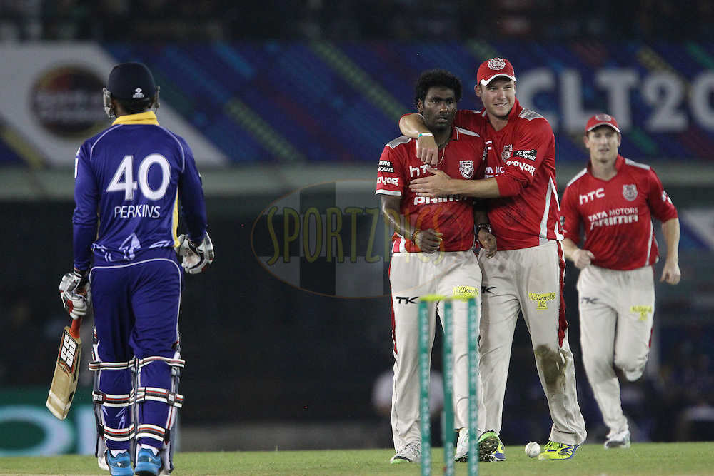 Parvinder AWANA  of the Kings XI Punjab celebrates the wicket of William PERKINS of the Barbados Tridents  with George BAILEY (Captain) of the Kings XI Punjab during match 5 of the Oppo Champions League Twenty20 between the Kings XI Punjab and the Barbados Tridents held at the Punjab Cricket Association Stadium, Mohali, India on the 20th September 2014<br /> <br /> Photo by:  Ron Gaunt / Sportzpics/ CLT20<br /> <br /> <br /> Image use is subject to the terms and conditions as laid out by the BCCI/ CLT20.  The terms and conditions can be downloaded here:<br /> <br /> http://sportzpics.photoshelter.com/gallery/CLT20-Image-Terms-and-Conditions-2014/G0000IfNJn535VPU/C0000QhhKadWcjYs