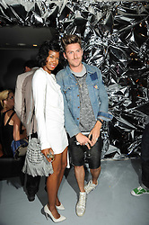 HENRY HOLLAND and TOLULA ADEYEMI at a party to celebrate the launch of Bang a new male fragrance by Marc Jacobs held at the Fith Floor Restaurant, Harvey Nichols, Knightsbridge, London on 22nd July 2010.
