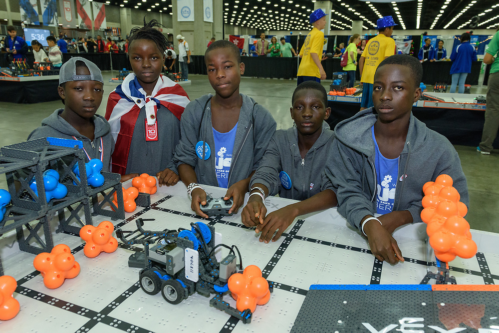 Team Ahjay, five students in the Wahjay-STEM robotics education program at the World Wide Mission Standard Academy (in partnership with the Nyonblee Cares Foundation) in Buchanan City, Liberia, participate in the International VEX Worlds 2017 competition Monday, April 24 in Louisville, Ky. Giewee Giah, CEO & Founder of the Wahjay-STEM, board member Jenny Spalding and teacher Onana N. Glassco accompanied students Dyuote Blaye, Samuel A. Gayne, Baby-Girl Jacobs, Nyundeh Gorwor and Blojay Moore as they competed in the VEX games held at the Kentucky Expostion Center. (Photo by Brian Bohannon)