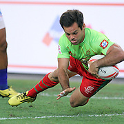 Portugal's 7's Captain, Pedro Leal, scores a try vs Manu Samoa in his team's 12-28 loss at the Singapore 7's, day 1, Singapore National Stadium, Singapore.  Photo by Barry Markowitz, 4/16/16
