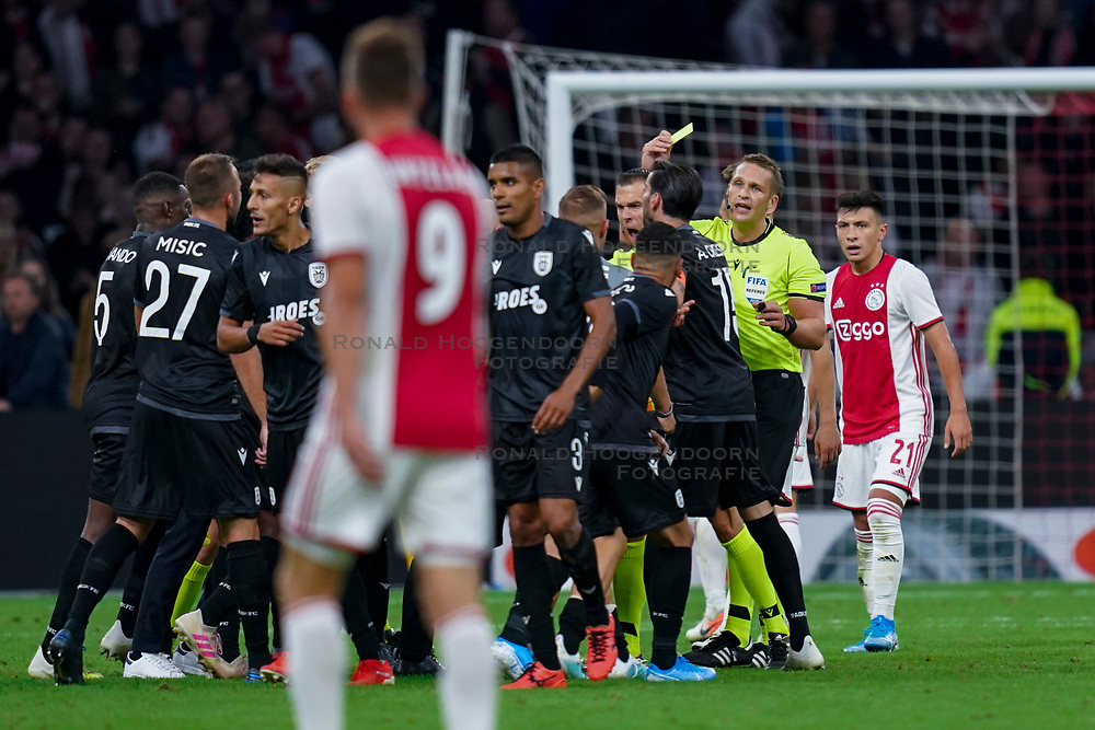 13-08-2019 NED: UEFA Champions League AFC Ajax - Paok Saloniki, Amsterdam<br />  Ajax won 3-2 and they will meet APOEL in the battle for a group stage spot / Coach Abel Fereira #Coach of PAOK, /Dimitris Limnios #18 of PAOK, discuss, yellow card