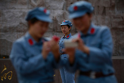 Chinese communist party course trainees dressed in Red Army uniforms visit the Jinggangshan Revolutionary Museum in Jinggangshan of Jiangxi Province, China, 14 October 2012. Jinggangshan or Jinggang mountain is a popular destination for Red Tourism where Chinese communist party cadres and ordinary Chinese tourists alike converge, seeking to relive the experiences and rekindle the spirit of the revolutionaries. It is deemed as the birthplace of the Chinese Red Army and the 'cradle of the Chinese revolution' which saw Communist leader Mao Zedong's ascent to power as a revolutionary. After a failed uprising in 1927, Mao fled into the mountains with his 1,000 remaining troops from nationalist forces and set up base here to reorganize his army, eventually defeating the Kuomingtang (KMT) to rule the country. Cadres dressed in Red Army uniforms attending Communist party training courses in are a common sight in the various historical sites of the mountain where they sing red songs and retrace the paths taken by their forbears. The Chinese communist party is slated to hold its 18th national congress on 08 November where a major leadership transition will see current leaders President Hu Jintao and Premier Wen Jiabao make way for a new generation of leaders helmed by Xi Jinping, With more than 80 million members, the Chinese Communist Party is hard pressed to display a show of unity and power after  scandals the ousting of disgraced politician Bo Xilai roiled the country. .