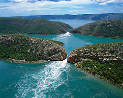 Aerial view of the Horizontal Waterfalls in Talbot Bay on the Kimberley coast.  The waterfalls are a pair of pinch rapids which funnel water through two narrow gaps in the McLarty Range.