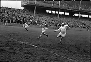Railway Cup Final. Famed Cork hurler, Christy Ring, in full flight at the match with Leinster in Croke Park