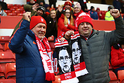 Forest fans with Nottingham Forest manager Martin O'Neill scarves during the EFL Sky Bet Championship match between Nottingham Forest and Bristol City at the City Ground, Nottingham, England on 19 January 2019.
