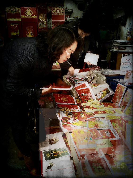 A vietnamese woman buys greeting cards images of vietnam and a vietnamese woman buys greeting cards hanoi vietnam southeast asia m4hsunfo