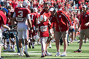 April 06, 2013: Jack Hoffman #22 gets a high five from Coach Bo Pelini after scoring a touchdown for the Red team during the Red-White spring game at Memorial Stadium in Lincoln, Nebraska. The Red team defeated the White team 30 to 21.