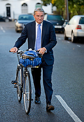 """© London News Pictures. 17/10/2013 . London, UK. MP ANDREW MITCHELL leaving his home in North East London. Three police officers have apologised for """"poor judgement"""" in talking to the media following meeting with Andrew Mitchell. Photo credit : Ben Cawthra/LNP"""