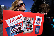 "A supporter of U.S. President Donald Trump holds a sign at a ""Spirit of America"" rally in Denver February 27, 2017.   REUTERS/Rick Wilking"