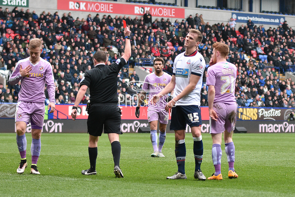 Referee Mr Geoff Eltringham sends off Bolton Wanderers Defender, Rob Holding during the Sky Bet Championship match between Bolton Wanderers and Reading at the Macron Stadium, Bolton, England on 2 April 2016. Photo by Mark Pollitt.