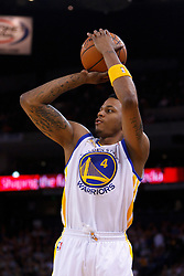 Feb 2, 2012; Oakland, CA, USA; Golden State Warriors shooting guard Brandon Rush (4) shoots against the Utah Jazz during the second quarter at Oracle Arena. Mandatory Credit: Jason O. Watson-US PRESSWIRE