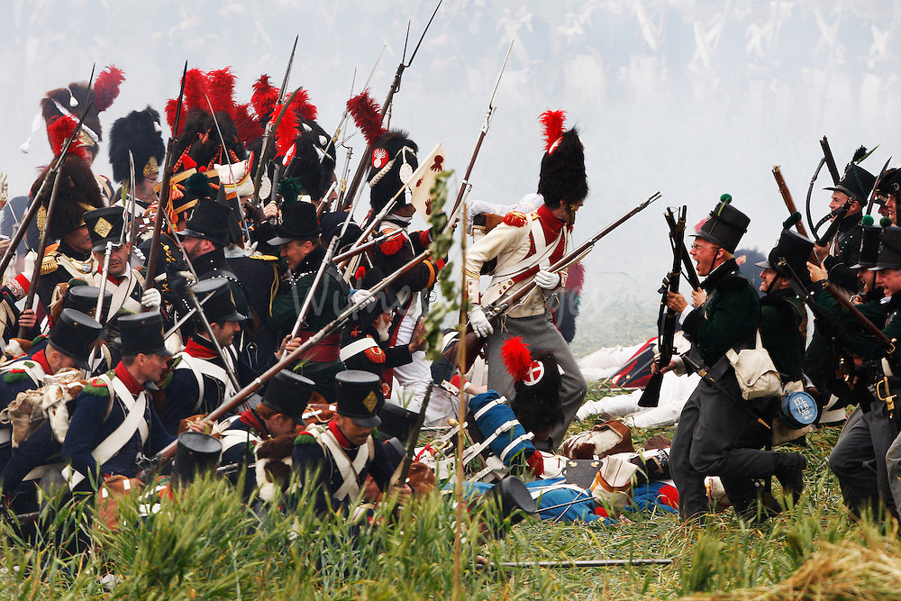 History enthusiasts, dressed as members of the French and British Army, fight during a re-enactment of Napoleon's famous battle of Waterloo in Braine-l'Alleud June 21, 2009. Brandishing guns and bayonets near Waterloo, just south of Brussels, some 1,200 men from 12 countries gathered on Sunday to re-enact the 1815 battle that ended Napoleon's imperial dream.  REUTERS/Thierry Roge     (BELGIUM SOCIETY IMAGES OF THE DAY)