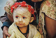 Unique Child Face with Thanaka Face Paint (notice protective cobra!), Sagaing, Myanmar / Burma