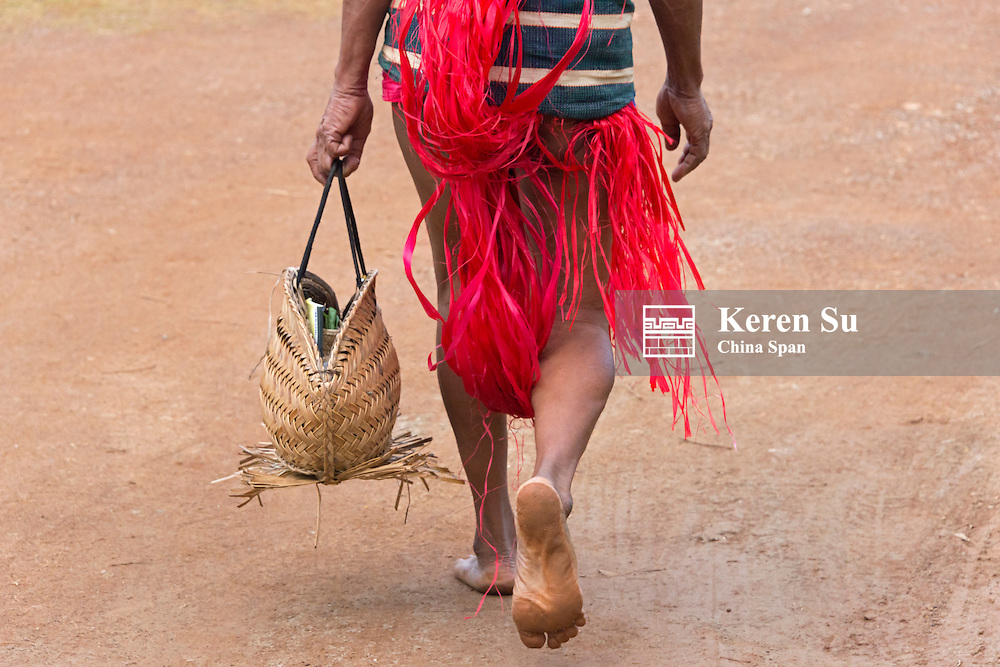 Yapese man in traditional clothing carrying hand bag at Yap Day Festival, Yap Island, Federated States of Micronesia