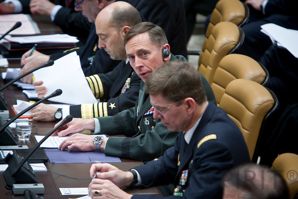 From left Admiral James Stavridis, Supreme Allied Commander Euope, General David Petraeus, Commander of ISAF, and Admiral Stephane Abrial, Supreme Allied Commander Transformation, at the beginning of the NATO Defence Ministers with non-NATO ISAF Contributing Nations in Brussels Friday 11 March 2011. PHOTO: ERIK LUNTANG / INSPIRIT Photo.