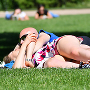 London, UK. 27 June 2019. UK Weather - People Suntan at the Hottest week in June 2019 at St James park, London, UK