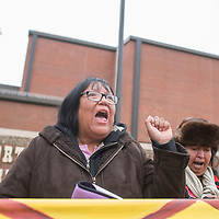 """Peggy McNew, left, chants """"water is life"""" while protesting outside the Morton County Sheriff office in Mandan, ND Tuesday waiting for six fellow protestors to be released from jail."""