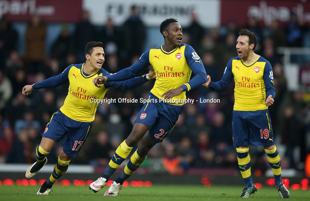 28 December 2014 Premier League Football - West Ham United v Arsenal; Danny Welbeck of Arsenal celebrates the second goal with Alexis Sanchez and Santi Cazorla.<br /> Photo: Mark Leech