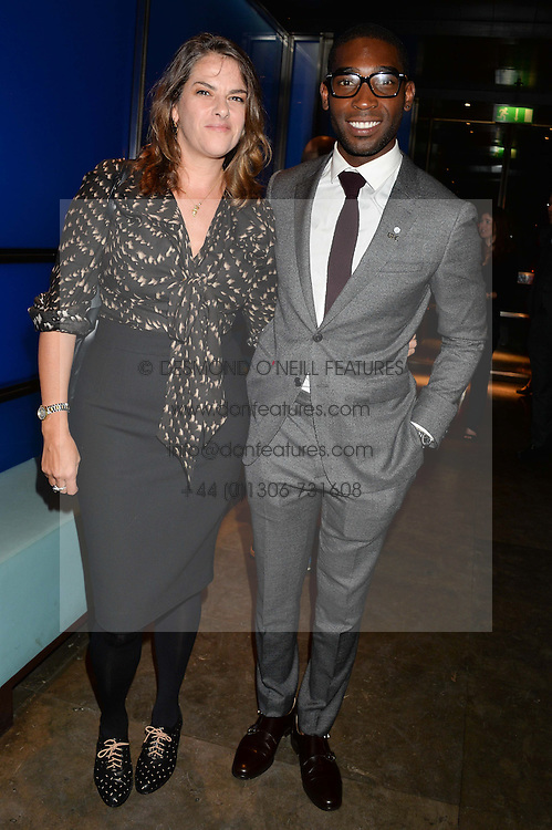 TRACEY EMIN and TINIE TEMPAH at a dinner hosted by Anya Hindmarch and Dylan Jones to celebrate the end London Collections: Men 2014 held at Hakkasan, 8 Hanway Place, London on 8th January 2014.