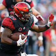 02 September 2017: San Diego State Aztecs running back Juwan Washington #29 rushes the ball for a short gain in the first quarter against the UC Davis Aggies. The Aztecs lead the Aggies 24-3 at the half at Qualcomm Stadium in San Diego, California. <br /> www.sdsuaztecphotos.com
