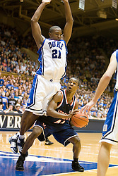 Virginia guard Sean Singletary (44) is fouled by Duke guard DeMarcus Nelson (21).  The Duke Blue Devils hosted the Virginia Cavaliers in men's basketball at Cameron Indoor Stadium on the campus of Duke University in Durham, NC on January 13, 2008.