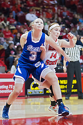 03 January 2014:  Lizzy Wendell and Alexis Foley wrestle for lane position during a free throw during an NCAA women's basketball game between the Drake Bulldogs and the Illinois Sate Redbirds at Redbird Arena in Normal IL