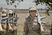 Sulaymaniyah, Iraq -  <br /> <br /> Female Fighters of The Peshmerga<br /> As ISIS has swept across northern Iraq, they have become known for their atrocities towards women. However, there's a group of women that aren't preparing to flee ISIS but instead are preparing to meet them with their AK-47s. The 2nd Peshmerga, are a battalion of Kurdish fighters 'Äì and they just happen to be an all-female soldiers. They're front line troops, some of whom have been fighting for years, and they are eager to face ISIS. Dressed in army fatigues and armed with rifles, they are ready to lay down their lives to protect the Kurdish homeland against the threat of ISIS. They carry out training exercises and look no different from other Kurdish soldiers - except for a hint of makeup on some faces and long hair escaping from their caps. The 2nd Battalion consists of 550 mothers, sisters and daughters and was formed in 1996. Over the past month, they have moved into disputed areas abandoned by Iraqi security forces during the Isis advance. They have also recently seized control of oil production facilities at Bai Hassan and Kirkuk - the female Peshmerga will now be part of a mission to secure the city and its surrounding oil fields.<br /> <br /> Women Peshmerga of the 2nd Battalion stand to attention during a military exercise.. <br /> ©Excluisvepix Media