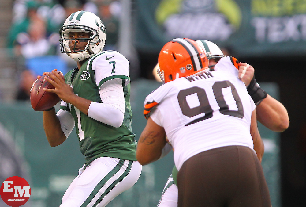 Dec 22, 2013; East Rutherford, NJ, USA; New York Jets quarterback Geno Smith (7) looks to pass while being rushed by Cleveland Browns defensive end Billy Winn (90) during the second half at MetLife Stadium.  The Jets defeated the Browns 24-13.