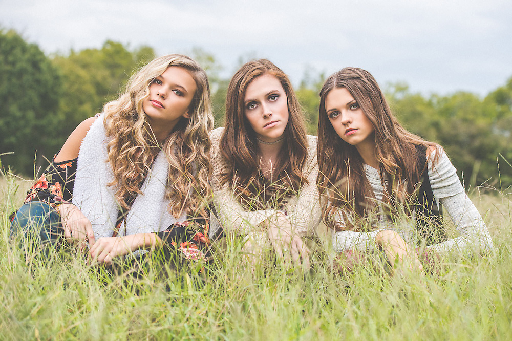Franklin Senior Portrait of 3 girls in a field posing in Fall clothing in Vampire Diaries styled photo shoot