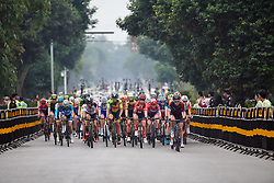 The peloton approach at GREE Tour of Guangxi Women's WorldTour 2019 a 145.8 km road race in Guilin, China on October 22, 2019. Photo by Sean Robinson/velofocus.com
