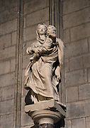 Low angle view of a Virgin with Child statue on November 23, 2008 in Notre Dame de Paris, Ile de la Cité, Paris, France. The Virgin with Child scuplture is one of the 37 representations of the Virgin housed by the cathedral. Notre Dame de Paris was initiated by the bishop Maurice de Sully and built between 1163 and 1345. Picture by Manuel Cohen