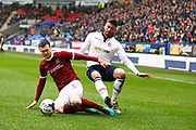 Bolton Wanderers Mark Beevers (5) and Northampton Towns Zander Diamond (5) during the EFL Sky Bet League 1 match between Bolton Wanderers and Northampton Town at the Macron Stadium, Bolton, England on 18 March 2017. Photo by Craig Galloway.