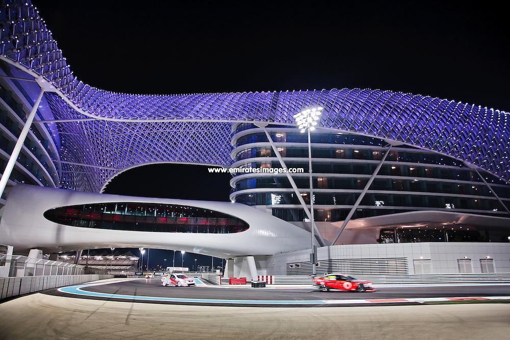 Car racing at Yas Marina Circuit Abu Dhabi. The Yas Hotel bridges the circuit