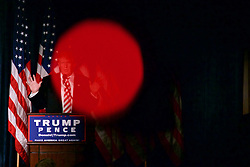 Republican Presidential Candidate Donald Trump is partly obscured by the light of a recording camera, belonging to the news media, as he speaks to a small crowd in Philadelphia, PA.