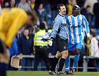 Photo: Scott Heavey.<br />Oxford United v Huddersfeild Town. Nationide Division Three. 06/03/2004.<br />Efe Sodje and Paul Rachubka (L) celebrate after the 1-0 victory