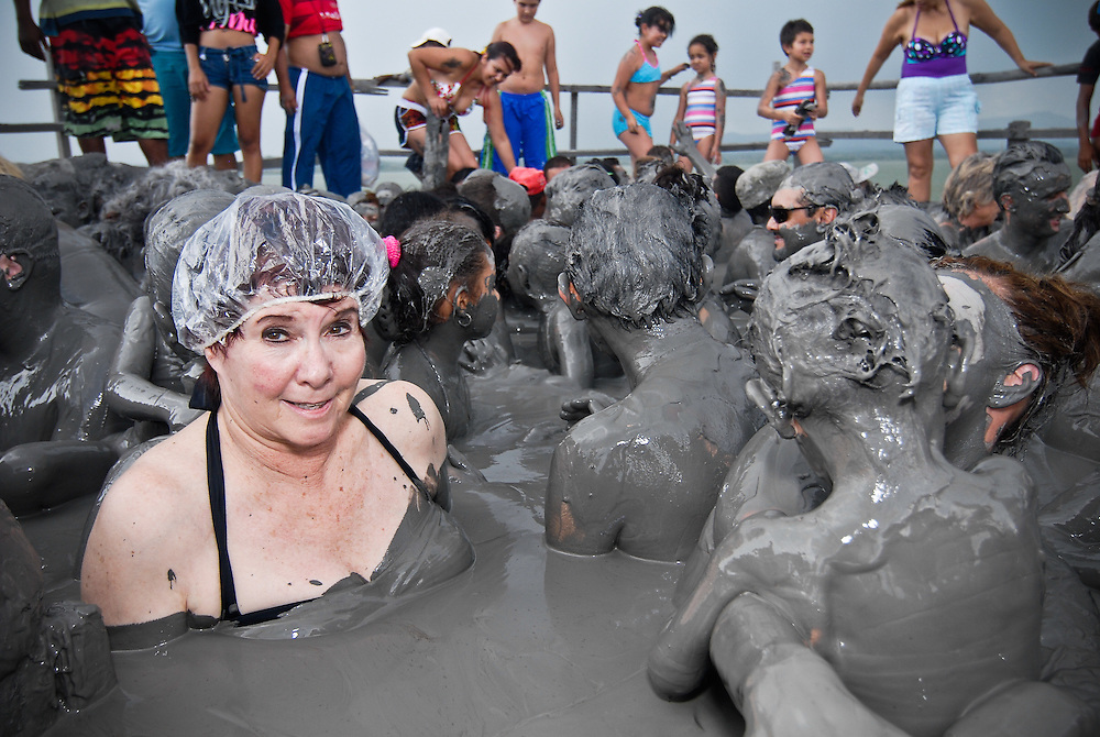 Tourists and locals get into the mud at Volcano Totumo in Colombia.