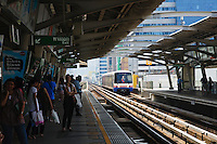 BTS train arriving at a station in Bangkok, Thailand