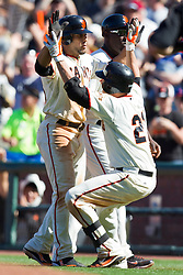 May 30, 2010; San Francisco, CA, USA;  San Francisco Giants second baseman Freddy Sanchez (21) congratulates center fielder Andres Torres (left) after hitting the game winning RBI against the Arizona Diamondbacks during the tenth inning inning at AT&T Park.  San Francisco defeated Arizona 6-5 in 10 innings.