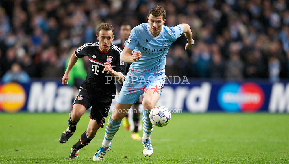 MANCHESTER, ENGLAND - Wednesday, December 7, 2011: Manchester City's Edin Dzeko in action against FC Bayern Munchen's Rafinha during the UEFA Champions League Group A match at the City of Manchester Stadium. (Pic by Vegard Grott/Propaganda)