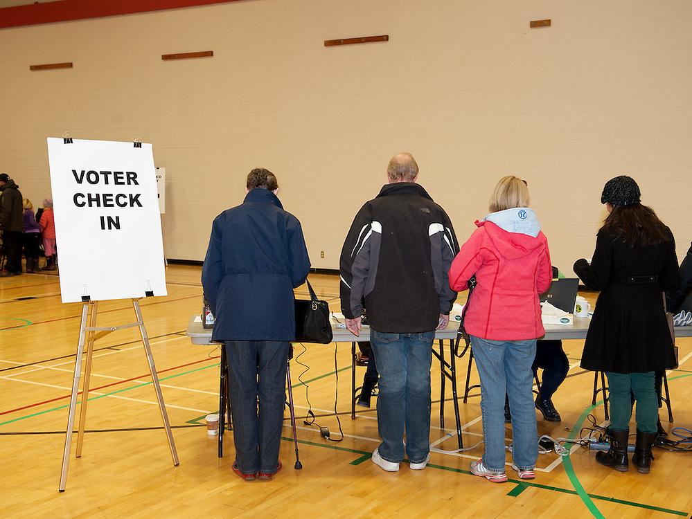 Municipal voting day at Myrtle Phillips Elementary School.  Saturday, November 15th, 2014.<br /> <br /> Photo Credit: David Buzzard