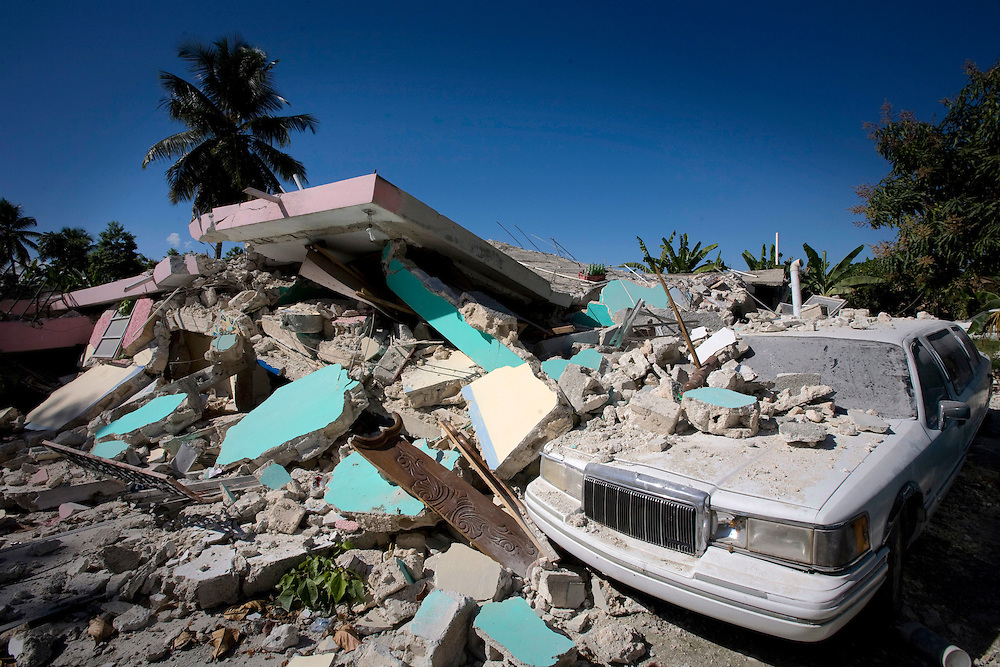 A limousine is buried under the rubble of a hotel in the city of Leogane , south of Haiti's capital Port-au-Prince on January 29, 2010.