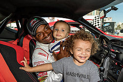 LONG BEACH, CA - APRIL 5  American actor, television director, dancer, and game show host Alfonso Ribeiro shared with his wife Angela Unkrich and children during media day for Pro/Celebrity Race at Toyota Grand Prix of Long Beach on 2016 April 5, in Long Beach, California. Byline, credit, TV usage, web usage or linkback must read SILVEXPHOTO.COM. Failure to byline correctly will incur double the agreed fee. Tel: +1 714 504 6870.