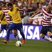 Neymar, Brazil, (left) is challenged by Michael Bradley, USA, during the USA V Brazil International friendly soccer match at FedEx Field, Washington DC, USA. 30th May 2012. Photo Tim Clayton