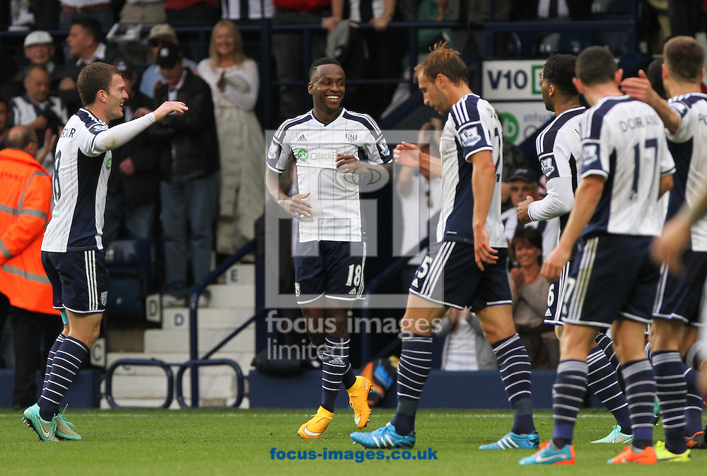 Saido Berahino (centre) of West Bromwich Albion celebrates scoring his sides second goal during the Barclays Premier League match at The Hawthorns, West Bromwich<br /> Picture by Tom Smith/Focus Images Ltd 07545141164<br /> 28/09/2014